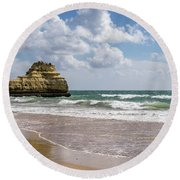 Sea Stack Sculpted Like A Ship Riding The Waves Round Beach Towel