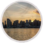 Seagull Flying At Sunset With The Skyline Of Boston On The Backg Round Beach Towel