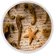 Seahorses And Starfish On Old Letter Round Beach Towel by Garry Gay