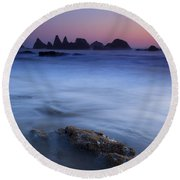 Seal Rock Glow Round Beach Towel