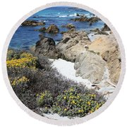Seaside Flowers And Rocky Shore Round Beach Towel
