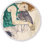 Seated Woman With Legs Drawn Up Round Beach Towel