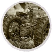 Sepia Toned Old Farmall Tractor In A Grassy Field Round Beach Towel