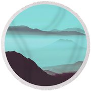Serene Scene Of A Early Morning Misty Clouds Rolling Over The Rugged Mountainous Terrain Round Beach Towel