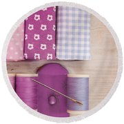 Sewing Threads Needle And Fabrics On A Wooden Box Round Beach Towel