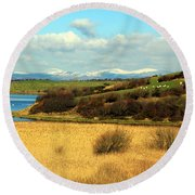 Sheep On The Hillside Round Beach Towel