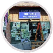 Shop Behind The Wall Round Beach Towel