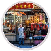 Shop Owner Standing In Front Of Poultry Shop On Temple Street Night Market Kowloon Hong Kong China Round Beach Towel
