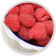 Side View Of Rasberries In Blue Bowl Round Beach Towel