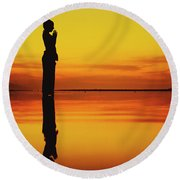 Silhouette Of A Girl Practicing Yoga Reflected On The Surface Of Water During Beautiful Sunset Round Beach Towel