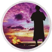 Silhouette Of A Local Man Standing By The Bonfire On The Beach In Maldives During Dramatic Sunset Round Beach Towel