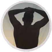 Silhouette Of A Man At Sunset Round Beach Towel