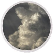 Silhouette Of An Eagle Flying Among Stormy Clouds  Round Beach Towel