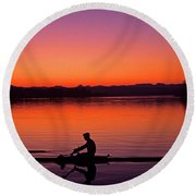 Silhouetted Man Rowing Round Beach Towel