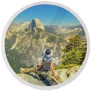 sitting at Glacier Point Round Beach Towel