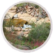Slide Rock With Pink Wildflowers Round Beach Towel