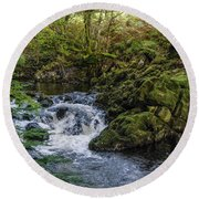 Small River Cascade Over Mossy Rocks In Northern Wales Round Beach Towel