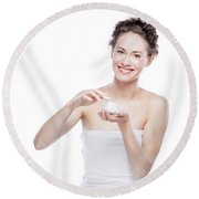 Smiling, Attractive Woman Using A Moisturizer. Round Beach Towel