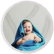Smiling Baby Tucked In A Warm Blanket Round Beach Towel