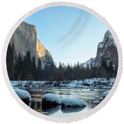 Snow On Large Rocks With El Capitan In The Background Round Beach Towel