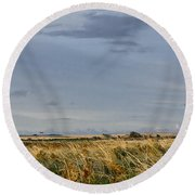 Something About Wind And Sun. Round Beach Towel