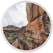 Spectral Light On The Cliffside Round Beach Towel