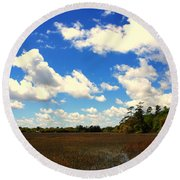 Spring Clouds Over The Marsh Round Beach Towel