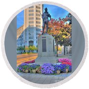 Statue In The Square Round Beach Towel