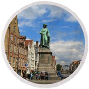 Statue Of Jan Van Eyck Beside The Spieglerei Canal In Bruges Round Beach Towel