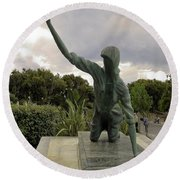 Statue Of Woman Crawling On Marble Street Round Beach Towel