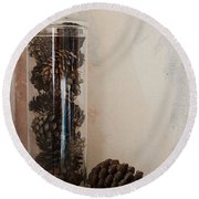 Still Life Of A Glass Jar Of Pine Cones Round Beach Towel