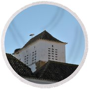 Stork And Nest On Roof In Faro. Portugal Round Beach Towel