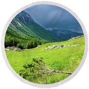 Storm Approaching Over Beautiful Green Field In Norway Round Beach Towel