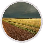 Storm Clouds Along A Saskatchewan Country Road Round Beach Towel