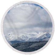 Storm Clouds And Snow On Pikes Peak Round Beach Towel