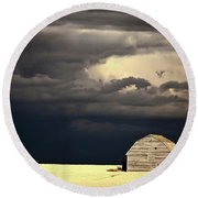 Storm Clouds Behind Abandoned Saskatchewan Barn Round Beach Towel