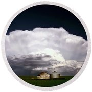 Storm Clouds Over Saskatchewan Granaries Round Beach Towel