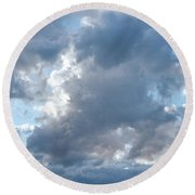 Storm Clouds Passing Round Beach Towel