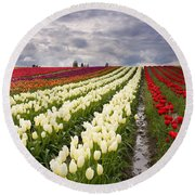 Storm Over Tulips Round Beach Towel by Mike  Dawson
