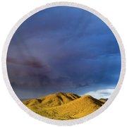 Storm Rolling Across Sun Dappled Mountains Round Beach Towel