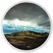 Stormy Mountains In Sunlight Round Beach Towel