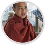 Street Portrait Of A Young Monk Round Beach Towel