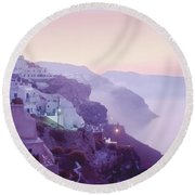 Sunrise In Oia Round Beach Towel