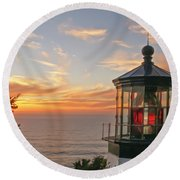 Sunset At Cape Meares Round Beach Towel