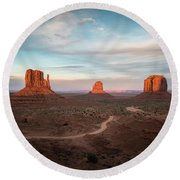 Sunset At Monument Valley Round Beach Towel by James Udall