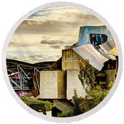 sunset at the marques de riscal Hotel - frank gehry Round Beach Towel