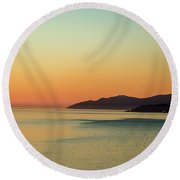 Sunset At The Ocean Round Beach Towel