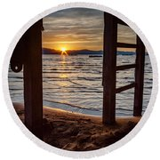 Sunset From Beneath The Pier Round Beach Towel