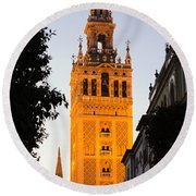 Sunset In Seville - A View Of The Giralda Round Beach Towel