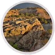 Sunset On Boulders Of Bentonite Site On Little Park Road Round Beach Towel